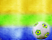 Vintage photo of soccer ball and Brazil flagflags' colos Royalty Free Stock Photography
