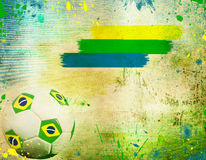 Vintage photo of soccer ball and the colors of the Brazil flag Stock Photography