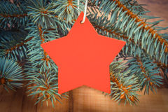 Vintage photo, Spruce branches and red wooden star with copy space for text Royalty Free Stock Photography