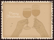 Vintage photo style Christmas card design with clink glasses. Hands with glasses of wine. Stock Photo