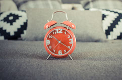 Vintage photo style of red alarm clock on bed Royalty Free Stock Image