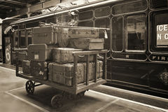 Vintage photo of suitcases next to the old train. Vintage photo of old suitcases next to the old steam train Royalty Free Stock Images