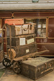Vintage photo of suitcases next to the old train. Vintage photo of old suitcases next to the old steam train Royalty Free Stock Photo