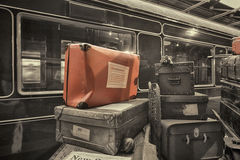 Vintage photo of suitcases next to the old train. Vintage photo of old suitcases next to the old steam train Royalty Free Stock Photos