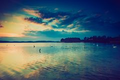Vintage photo of sunset over calm lake Royalty Free Stock Photography