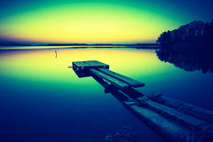 Vintage photo of sunset over calm lake Royalty Free Stock Photos