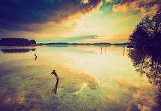 Vintage photo of sunset over calm lake Royalty Free Stock Images