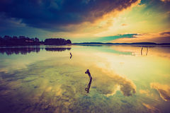 Vintage photo of sunset over calm lake Stock Image