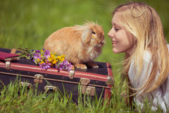 Vintage photo of teenager girl with bunny in the nature Royalty Free Stock Photography