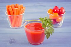 Vintage photo, Tomato juice and vegetables on blue board, healthy nutrition Royalty Free Stock Photos