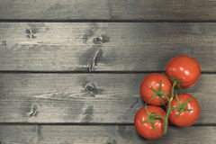 Vintage photo of tomatoes on a wooden desk Royalty Free Stock Photography