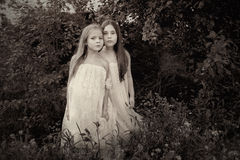 Vintage photo of two girls stock images