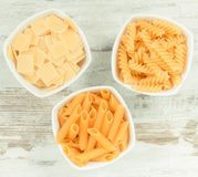 Vintage photo, Various mix pasta in bowls as source carbohydrates and fiber royalty free stock photography