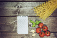 Vintage photo of vegetable, pasta and paper notebook Stock Photography