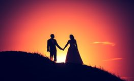 Vintage photo of wedding couple silhouettes in outdoor royalty free stock photo