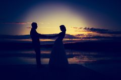 Vintage photo of wedding couple silhouettes in outdoor Stock Photo