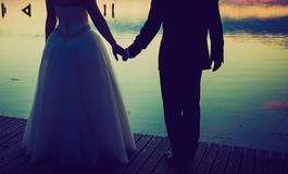 Vintage photo of wedding couple silhouettes in outdoor Stock Images