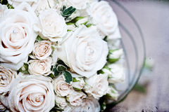Vintage photo of white wedding bouquet. Vintage photo close up of white wedding bouquet lying on the floor Royalty Free Stock Images