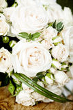 Vintage photo of white wedding bouquet. Vintage photo close up of white wedding bouquet lying on the floor Stock Photography