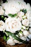 Vintage photo of white wedding bouquet. Vintage photo close up of white wedding bouquet lying on the floor Stock Photo