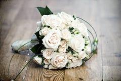 Vintage photo of white wedding bouquet. Lying on the floor Stock Image