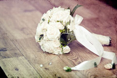 Vintage photo of white wedding bouquet. Lying on the floor Stock Photography