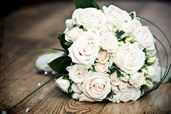 Vintage photo of white wedding bouquet. Lying on the floor Royalty Free Stock Photography