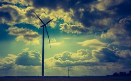 Vintage photo of windmills standing on corn field Stock Image