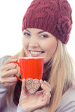 Vintage photo, Woman in cap and shawl holding gingerbreads and cup of tea Stock Photos