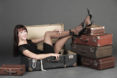 Vintage photo of a woman in a suitcase Royalty Free Stock Photography