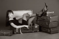 Vintage photo of a woman in a suitcase Stock Image