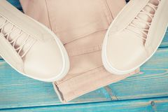 Vintage photo, Womanly leather shoes and pants on old blue boards. Vintage photo, Womanly pink leather shoes and pants on old blue boards Royalty Free Stock Image