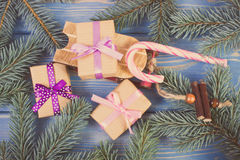 Vintage photo, Wooden sled and wrapped gifts with ribbons for Christmas, spruce branches Stock Photography