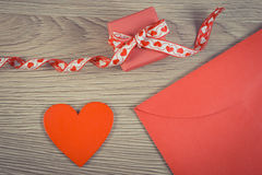 Vintage photo, Wrapped gift, red heart and love letter for Valentines Day, copy space for text Royalty Free Stock Image