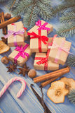 Vintage photo, Wrapped gifts with ribbons for Christmas, spices and spruce branches Stock Photo