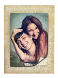 Vintage photo of a young couple in love. Vintage picture in an old cardboard frame of a young couple in love Royalty Free Stock Image