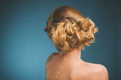 Vintage photo of a young woman with blonde hair. Back side. Royalty Free Stock Image
