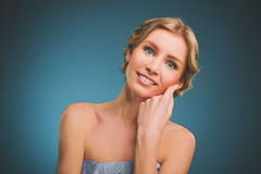 Vintage photo of a young woman with blonde hair and a toothy smile. Royalty Free Stock Photography