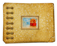 Vintage photoalbum for photos with gift boxes. And beautiful golden bow on white isolated Royalty Free Stock Photo
