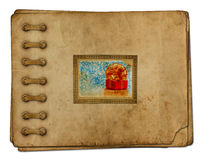 Vintage photoalbum for photos with gift boxes. And beautiful golden bow on white isolated Royalty Free Stock Photos