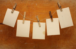 Vintage photographs hang on the clothespin Stock Images