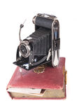 Vintage photography camera with old photoalbum. Over white Royalty Free Stock Photos