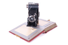 Vintage photography camera with old photoalbum. Over white Royalty Free Stock Images