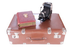 Vintage photography camera with old photoalbum. On a suitcase over white Royalty Free Stock Photography