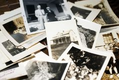 Vintage photos. A collection of family photos scattered on tiles stock photos