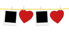 Vintage photos frame on the clothesline with hearts over white Royalty Free Stock Photography