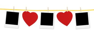 Vintage photos frame on the clothesline with hearts over white Stock Photography