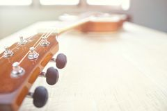 Acoustic guitar strings on wooden table in the room, close up top view and sunlight with empty space for you text. Vintage phto of acoustic guitar strings on stock photography