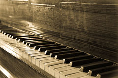Vintage piano. In old fashioned toned Royalty Free Stock Photos