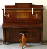 Vintage piano with candles church Stock Images
